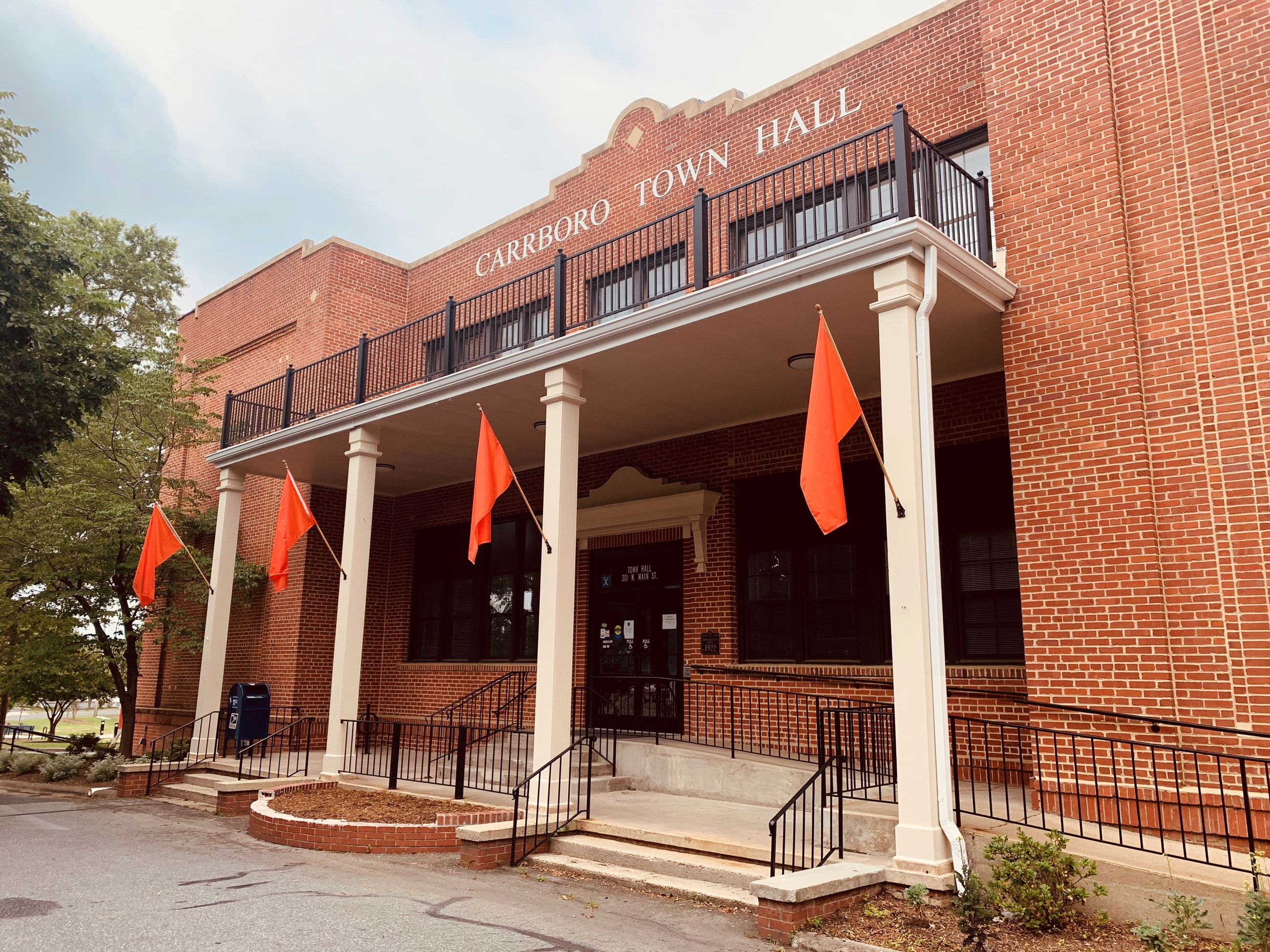 Orange flags at Carrboro Town Hall